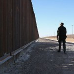 Border Patrol Agents Monitor Fence On U.S.-Mexico Border